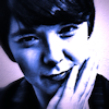yosiasing: Photo of me with a blue filter. (Default)