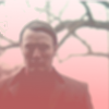 kindkit: A blurred, ominious image of Hannibal Lecter under a tree. (Hannibal: Hannibal red)