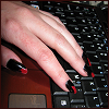 ruuger: My hand with the nails painted red and black resting on the keyboard of my laptop (Paikea)