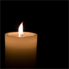 kate: Single lit white pillar candle (Candle: single lit white pillar cnadle)