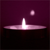 kate: Purple widemouthed lit candle in ceramic bowl (Candle: single purple)