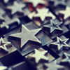 laceblade: Metallic moveable type of stars, varying sizes; some are outlines, some solid. ~13 visible (metal stars)