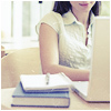 sweet_sparrow: A girl sitting behind a laptop with a book and notebook beside her. (P: Geeky)