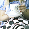 curator: (tea party with alice in wonderland.) (Default)