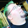textish: Picture of me circa 2001 (with green spiked hair action!) (green hair, The John Glenn Pose, thoughtful)