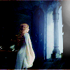 muccamukk: Éowyn in a white robe facing light streaming in from a window. (LotR: Éowyn's Dawn)