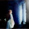 muccamukk: Éowyn in a white robe facing light streaming in from a window. (LotR: Éowyn's Dawn)