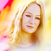 muccamukk: Éowyn smiling faintly, srrounded by yellow and pink light. (LotR: Éowyn in Gold)