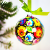 sylvaine: Christmas bauble decorated with traditional Polish patterns and colouring. ([gen:pol] wycinanki xmas)