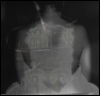 a black and white image of a seated woman from behind superimposed on a stack of washers