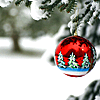 arethinn: red Christmas tree bauble with snowy tree background (seasonal yule (ornament))