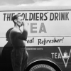 "kindkit: 'A man in WWII-era military uniform drinks tea in front of a van painted with ""The Soldiers' Drink: Tea"" (Fandomless: Soldiers drink tea)"