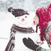 bluiis: (woman kissing snowman by shalowater)